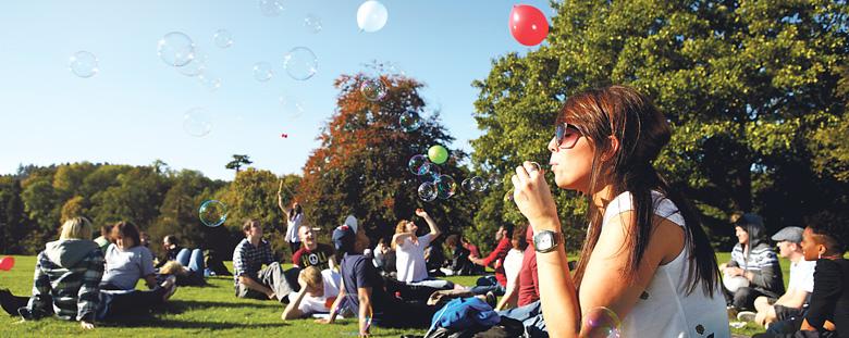 Student blowing soap bubbles
